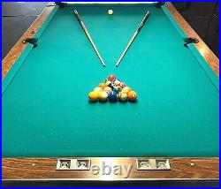9-foot, professional size, tournament pool table with a 3-piece slate base
