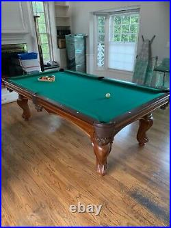 Brunswick Pool Table with Cues and Accessories. Excellent condition