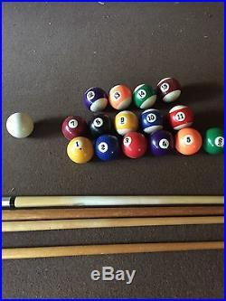 Pool Table 8'6 L x 5' wide, brown top, 15 balls, brush, chalk, 4 cues, no rack