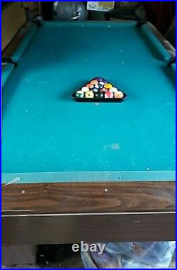 Pool table 8 foot by 4 in good condition, green felt with rack and balls